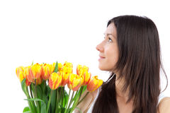 Young woman with yellow tulips bouquet of flowers Stock Photo