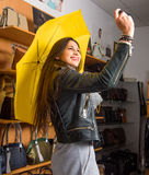 Young woman with yellow umbrella taking selfie Royalty Free Stock Photos
