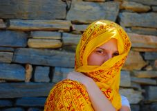 Young woman with yellow veil Stock Photography