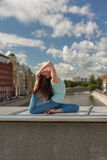 Young woman in a yoga bend pose on a bridge Stock Image