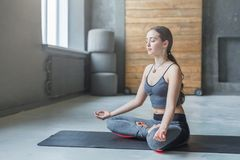 Young woman in yoga class, relax meditation pose Royalty Free Stock Photography