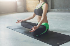 Young woman in yoga class, relax meditation pose Stock Photo