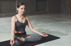 Young woman in yoga class, relax meditation pose Stock Photography