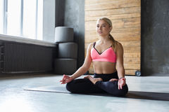 Young woman in yoga class, relax meditation pose Stock Images