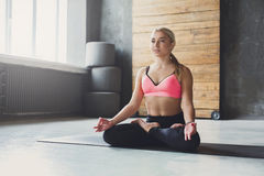 Young woman in yoga class, relax meditation pose Stock Photos