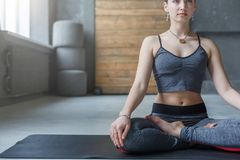 Young woman in yoga class, relax meditation pose Royalty Free Stock Images