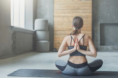 Young woman in yoga class, Reverse Prayer Pose Royalty Free Stock Photos