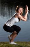 Young woman yoga lake Stock Photography