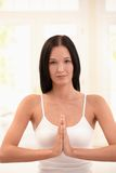 Young woman at yoga meditation Stock Photos