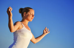 Young woman during yoga meditation. On the beach Royalty Free Stock Photos