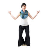 Young woman with yoga mudra hand gesture posing and smiling at camera. Royalty Free Stock Photography