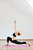 Young woman in yoga pose Royalty Free Stock Photography