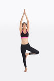 Young woman in yoga pose. Royalty Free Stock Photography