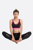 Young woman in yoga pose. Stock Photos