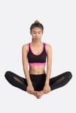 Young woman in yoga pose. Asian woman training in yoga Baddha Konasana Bound Angle Pose  isolated on white background Stock Photos