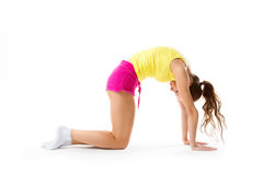 Young woman in a yoga pose, dressed in sports clothes Royalty Free Stock Photo