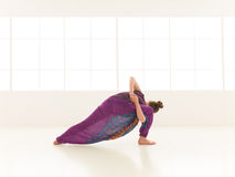 Young woman in yoga pose indor Stock Photos