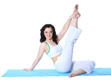 Young woman in yoga pose. On isolated white background Stock Photography