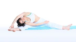 Young woman in yoga pose Stock Images