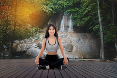 Young woman in yoga pose sitting Stock Photography