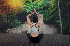 Young woman in yoga pose sitting Stock Images