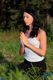 Young woman in yoga position Royalty Free Stock Photos