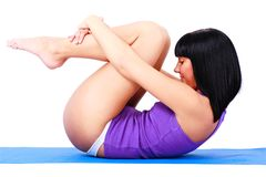 Young woman in yoga position Royalty Free Stock Images