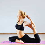 Young woman in yoga position indoors Royalty Free Stock Photo