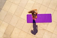Young woman in yoga position in sunny day, outdoor, view from ab Royalty Free Stock Photography