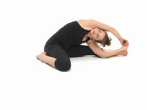 Young woman in yoga posture Royalty Free Stock Photos
