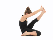 Young woman in yoga posture Stock Images
