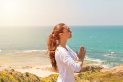 Young woman yoga on the  sea beach Royalty Free Stock Photography