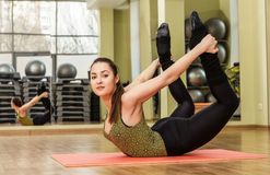 Young woman in a yoga stretching bow pose Royalty Free Stock Images
