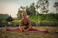 Young woman yoga stretching stock images