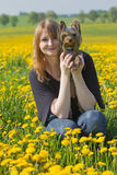 Young woman with Yorkshire terrier puppy. Stock Photo