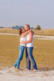 Young woman and a young man kissing Stock Photos