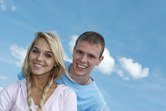 Young woman and young man laugh Stock Image