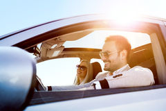 A young woman and a young man are laughing in the car Stock Photography