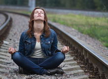 Young woman zen railway Stock Images