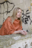 Young womanan Looking Forward With Anticipation. In old castle, in orange poncho Royalty Free Stock Photo