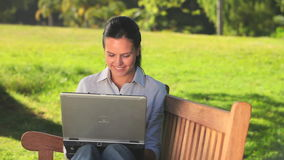 Young womann using a laptop outdoors Royalty Free Stock Images