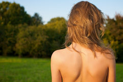 Young womans back in the forest Royalty Free Stock Photos