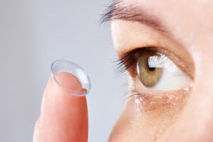 Young womans eye and contact lens Stock Images