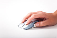 A young womans hand and a computer mouse. Young womans hand and a computer mouse Royalty Free Stock Photos