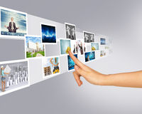 Young womans hand touching holographic pictures Stock Photos