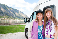 Young womans near the motorhome Royalty Free Stock Photos