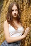 Young womans portrait with hay background. Stock Image
