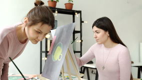 Young womans working on painting in a workshop 4k 20s. Young womans woman working on painting in a workshop 4k 20s stock footage
