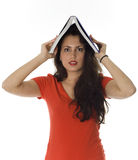 Young womanv keeping book on her head Royalty Free Stock Image