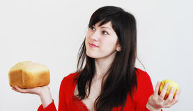 Young womanwith bread and  apple Stock Photography